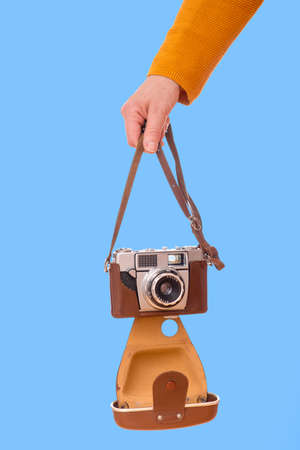 Woman holds nostalgia camera in her hands