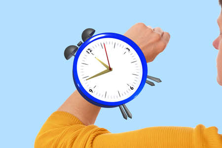 Woman has an alarm clock on her wrist