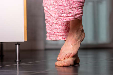 Woman with bare feet on the tile Stock fotó