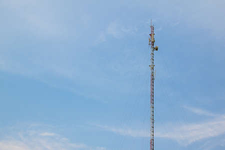 Mobile phone communication repeater antenna tower in blue sky photo