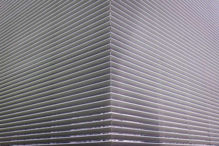 texture of steel ventilation grille on the wall of a building photo