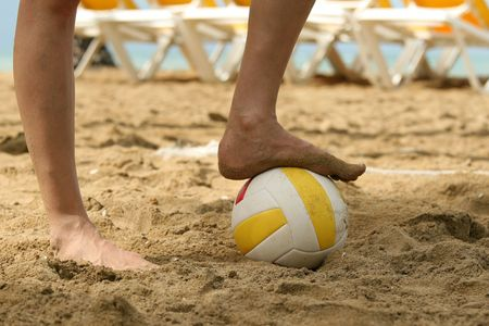 playing soccer with volleyball on the beach Stock Photo - 2339778