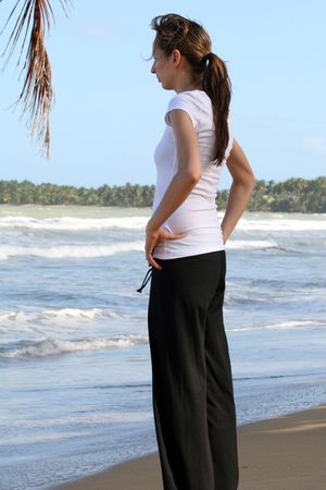 breath and relaxing exercises on the beach photo