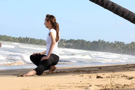 Stretching and yoga exercises on the beach photo