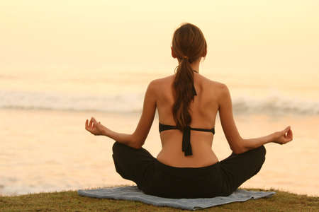 yoga and breath exercises by the sunset photo