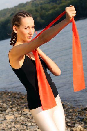 elastic band: Woman trains with elastic band Stock Photo