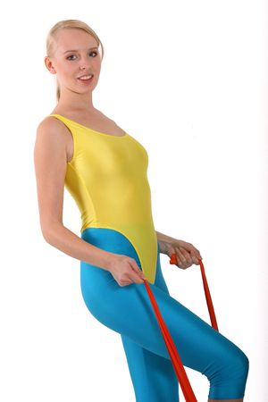 lycra: woman doing sport exercises with elastic band Stock Photo