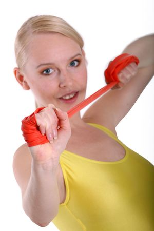elastic band: Girl trains in studio with elastic band Stock Photo