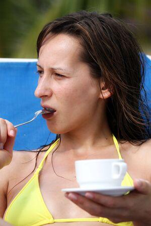 woman in bikini drinking coffee photo