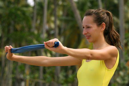 ejercicios con la banda el�stica  Foto de archivo - 2489260