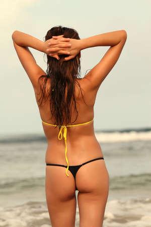 shot of female back on the beach photo