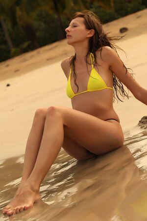 woman takes a sunbath in the caribbean photo