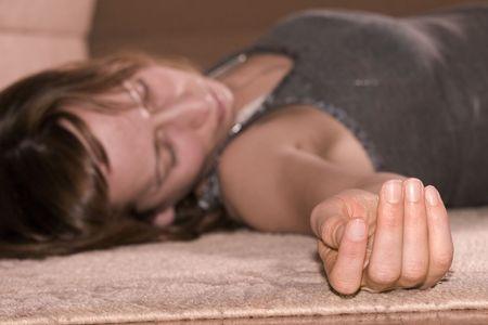 dead woman lying on the floor, focus on the hand photo