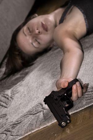 dead woman lying on the floor gun in the hand Stock Photo - 3277468