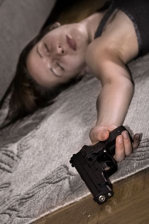 dead woman lying on the floor gun in the hand photo