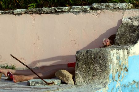 woman playing dead, lying in the corner of old house
