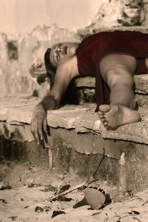 woman playing dead, lying on the stairs Stock Photo - 3754900