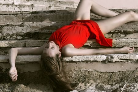 actress: beautiful woman playing dead, lying on the stairs