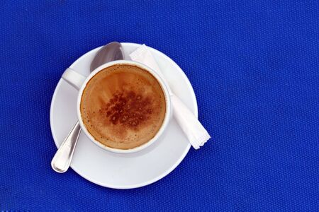 capuccino: cup of capuccino on the blue background Stock Photo
