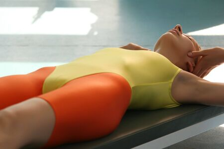 lycra: Woman in yellow leotard doing stretching exercises