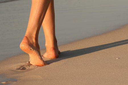 woman foot: female feet, walking on the caribbean beach Stock Photo