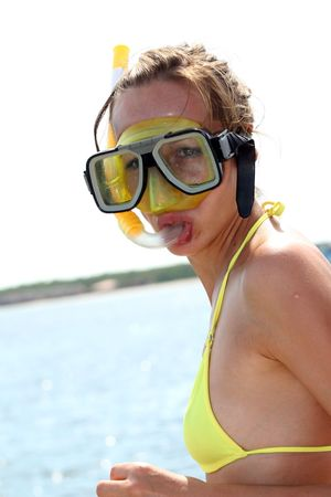 scuba goggles: woman in snorkel mask by caribbean sea