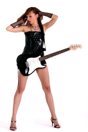 woman in patent leather playing guitar and singing photo