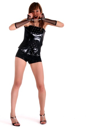woman in patent leather with handcuff screaming Stock Photo - 4209826