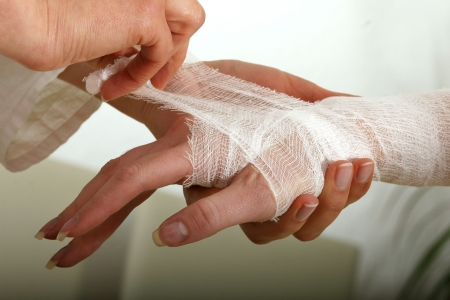 Applying Hand Bandage