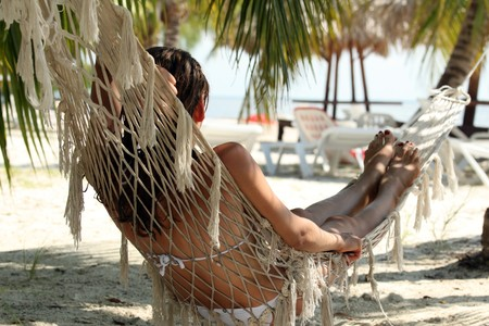 woman relaxing on hammock on the caribbean beach Stockfoto