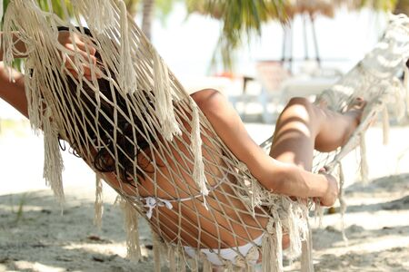 woman relaxing on hammock on the caribbean beach photo