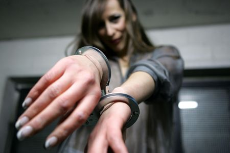 handcuffed: Model posing in handcuffs Stock Photo