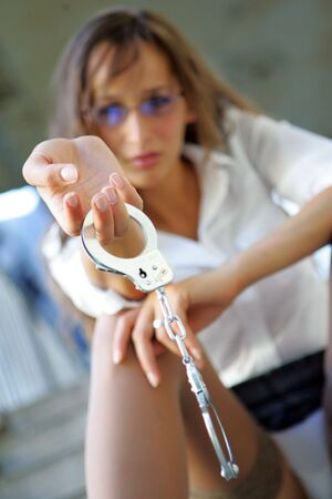 Woman posing with handcuffs