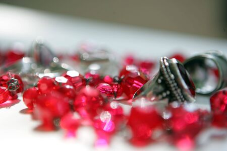 frippery: Ruby chain and the ring on the white table Stock Photo