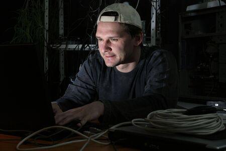 hacker on computer in his dark basement Stock Photo - 4708673