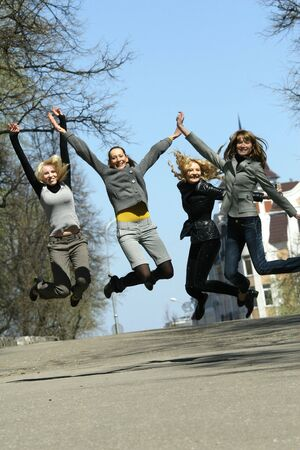group of girls jumping on the street Stock Photo - 4833520