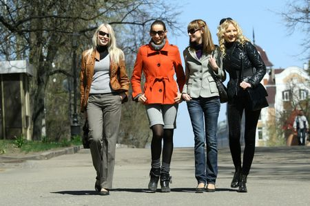four fashion women walking on the street Stock Photo