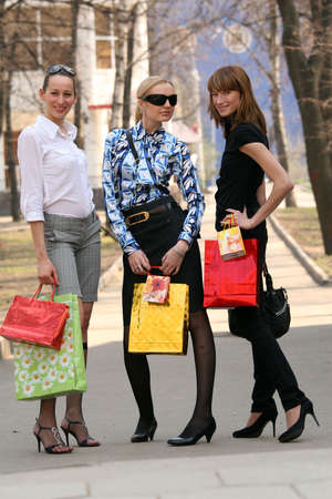 shopping women with bags on the street photo