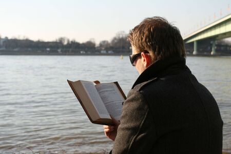 man reading book outdoor by the river Stock Photo - 4880330