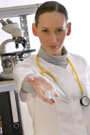 doctor giving pills: female doctor giving pills Stock Photo