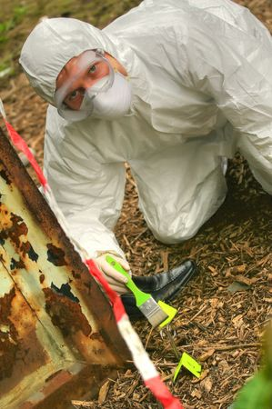 criminologist: criminologist investigates a crime scene outdoor