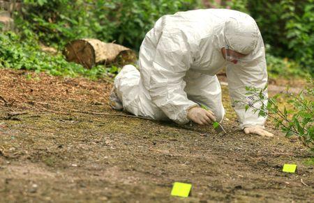 criminologist investigates a crime scene Stock Photo - 4977542