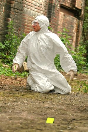 criminologist: criminologist investigates a crime scene Stock Photo