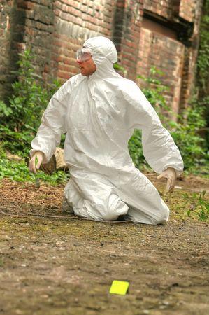 criminologist investigates a crime scene Banco de Imagens - 4977565