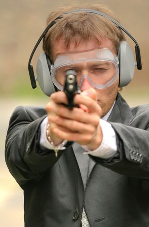 businessman aiming with a gun into the camera Stock Photo - 5000699