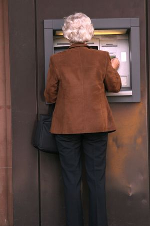woman withdrawing money from bank Stock Photo