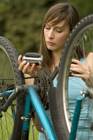 woman repairs a bike Stock Photo - 5203299