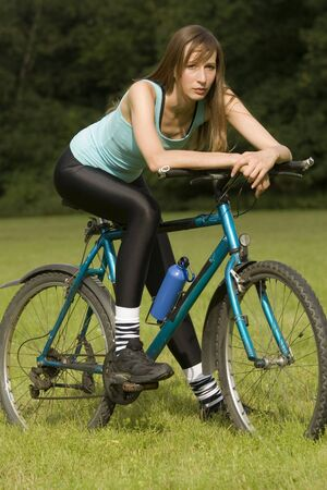 fitness woman relaxing on a bike outdoor photo
