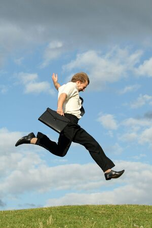 happy businessman running in the air photo