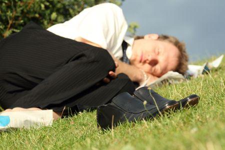 jobless businessman sleeping in a city park photo